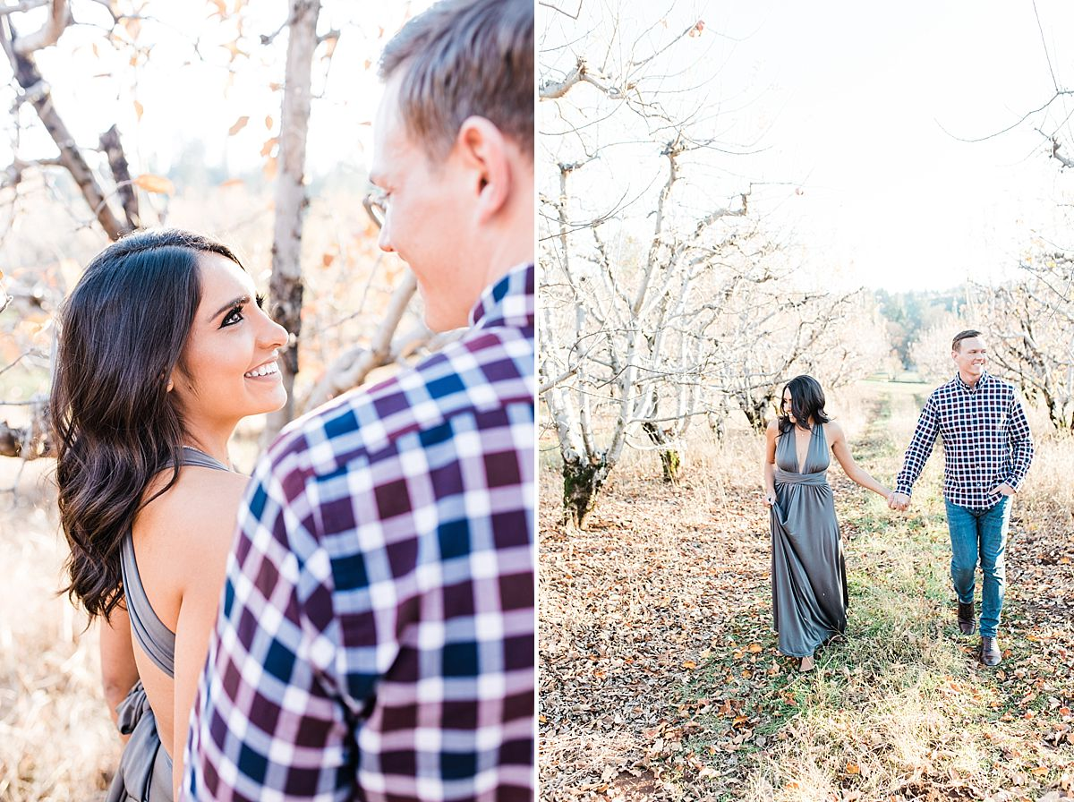 Apple Hill Engagement Session - Ashley Baumgartner - couple walking in apple orchard