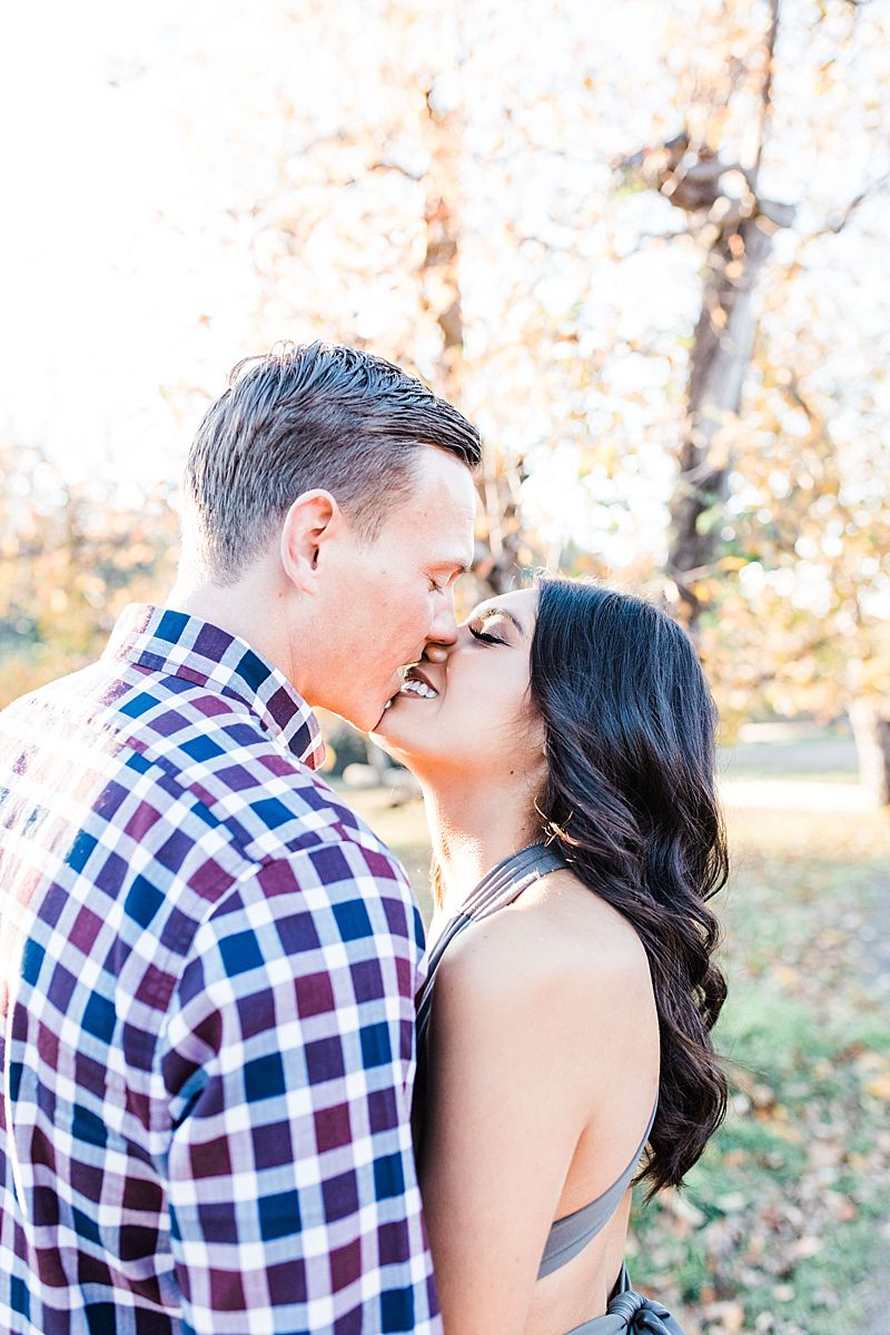 Apple Hill Engagement Session - Ashley Baumgartner - fiances kissing in apple orchard
