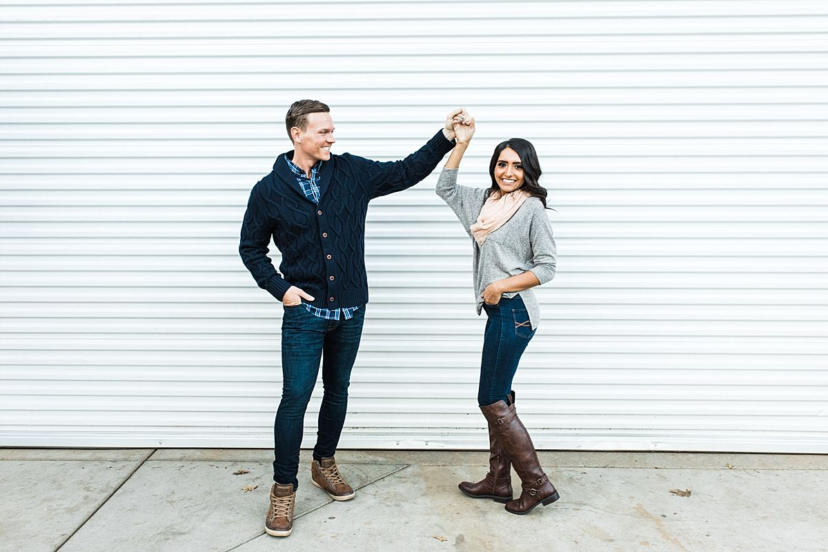 Apple Hill Engagement Session - Ashley Baumgartner - twirling in riding boots and a pink scarf