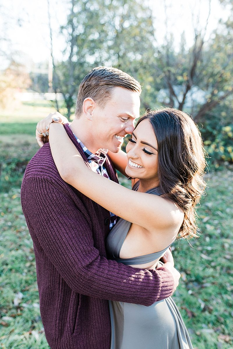 Apple Hill Engagement Session - Ashley Baumgartner - engaged couple giggling