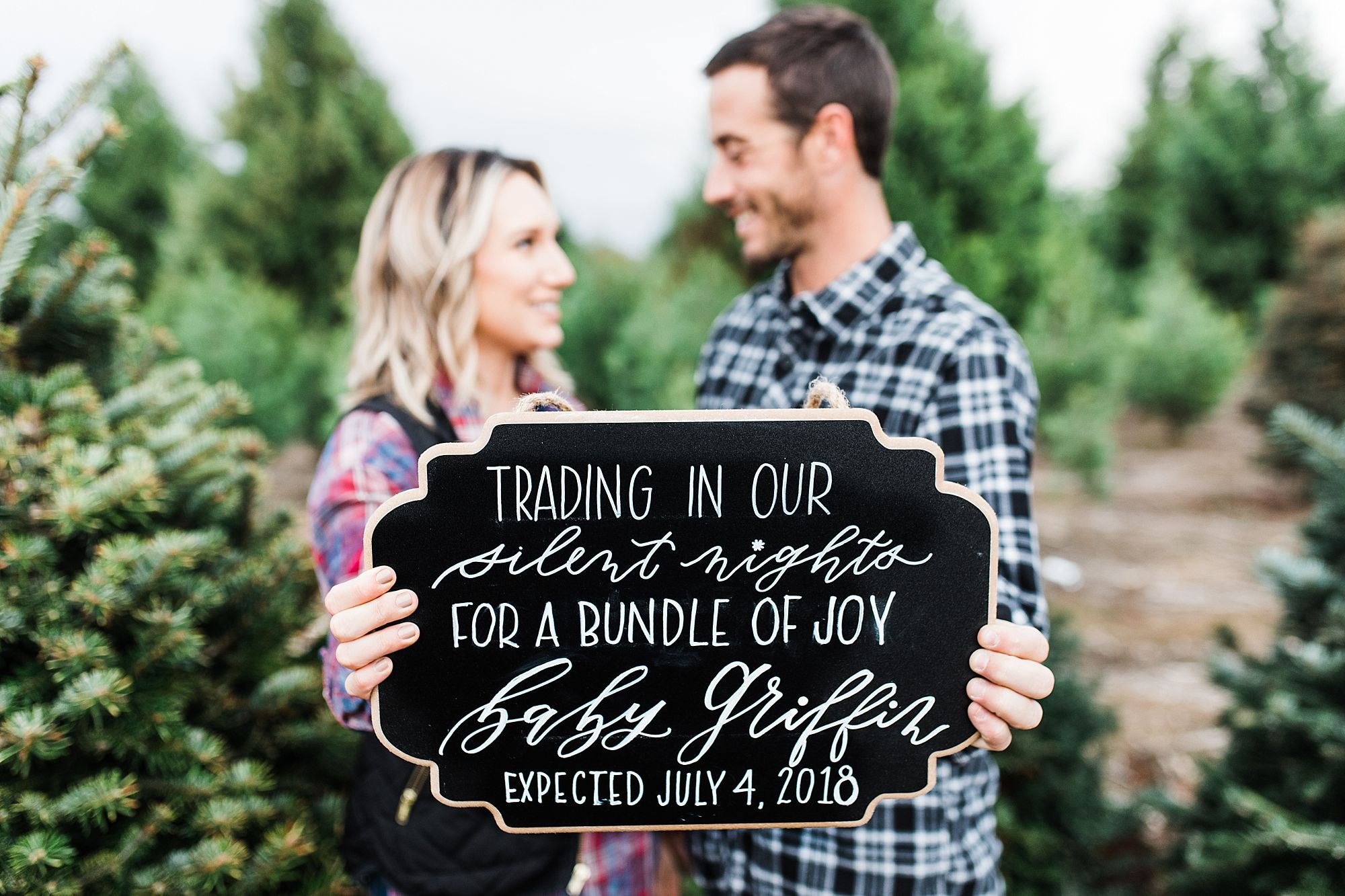 christmas baby announcement at tree farm brittani tyler ashley baumgarnter_0019 jpg